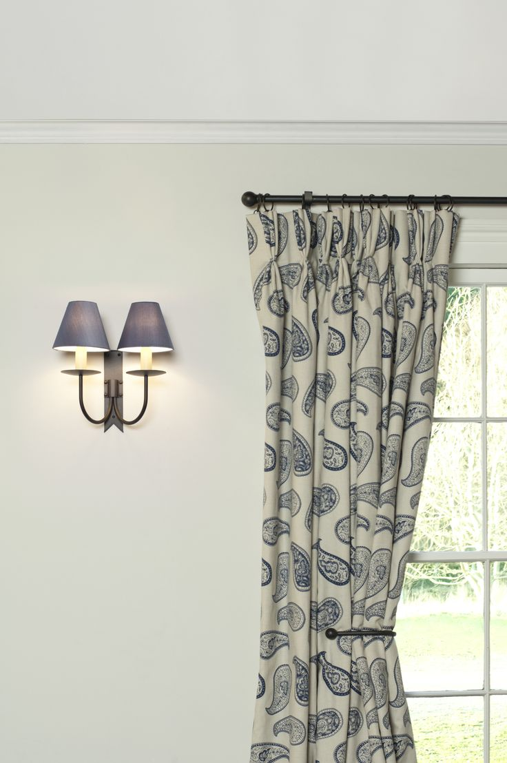Our popular Cottage Wall Light in traditional Beeswax finish paired with Slate Blue Silk Candle Shades and Indigo Blue Paisley Curtains.