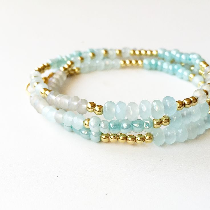 Aquamarine, turquoise, blue and gold crystal and glass bead bracelet.