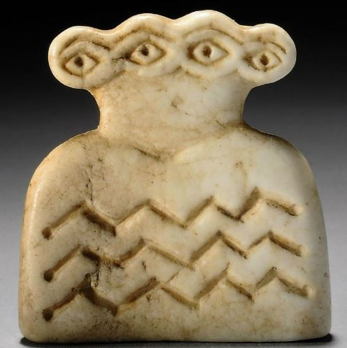 Syrian marble double eye idol, Tell Brak, 4th millenium B.C.  The thin plaque with four eyes with continuous single brow above, the body decorated with three zigzag lines, 4.5 cm high. Private collection