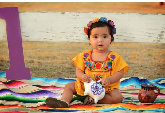 Baby first photo shoot fiesta Spanish theme colorful cantarito outdoor pictures Zarape cinco de mayo Candy colorful