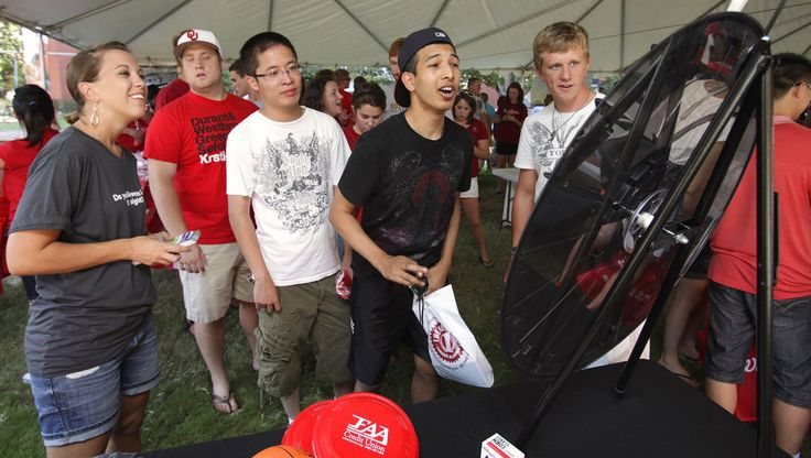 Daryn Singh (black shirt center), Berkeley, Calif. sophomore, reacts to spinning a prize wheel during the University of Oklahoma Sooner Kickoff Festival sponsored by the Norman Chamber of Commerce on Friday, August 20, 2010, in Norman, Okla. Read more about the Prize Wheel at https://PrizeWheel.com/blog/.