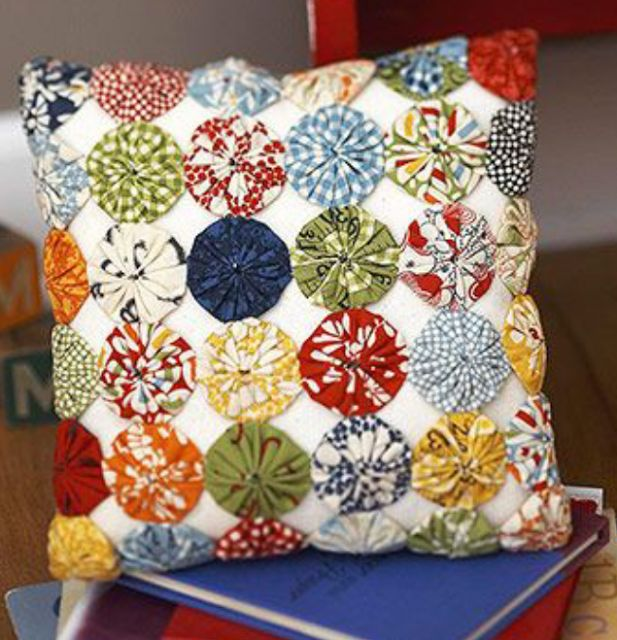 colorful yoyo pillow make a pillow reminiscent of one at house cut a square pillow top and cover it with colorful little fabric yoyos