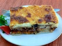 Moussaka - A Greek casserole made by layering eggplant with spiced meat filling then topped with creamy bechamel sauce, baked till golden perfection.