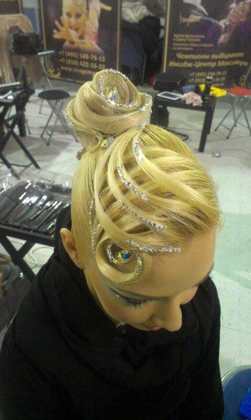 High bun with elevated basket weave design and rhinestones. Great hairstyle for standard, but can be worn for latin as well. Visit http://ballroomguide.com/comp/hair_make_up.html for more hair and makeup info