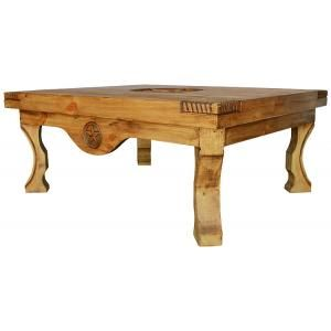 If you're looking for a unique rustic coffee table, this Yugo table features carved corners, bowed legs, and three carved stars.  The large distressed pine tabletop is accented beautifully by the large carved star on top and there's plenty of surface space for playing games and spreading out the newspaper. Made by hand in Mexico, the southwestern style blends well with most furniture designs.