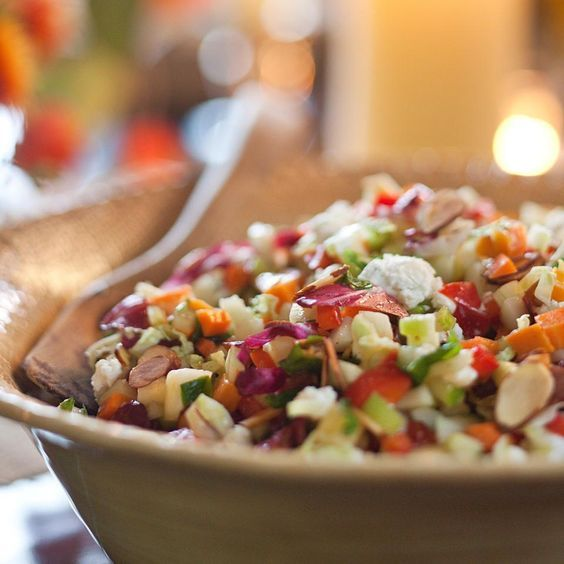 When Paul Newman and Michel Nischan opened their Westport, Connecticut, restaurant Dressing Room, Paul's request was that the menu always include a chopped salad that you could eat with a spoon. This chopped salad recipe is full of great flavors, colors and textures, featuring celery, carrots, red pepper, apple, cucumber, greens, cabbage, goat cheese and almonds. This is great for any holiday meal: you can let it stand and it stays crisp.