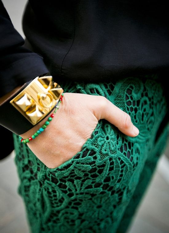 Emerald green lace pants. Hermes bracelet.