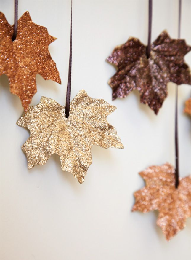 DIY Glittery leaf   You'll need a bag of artificial leaves, Use a paintbrush to apply Elmer's glue to each leaf and then sprinkle glitter over the leaf. Let the glue set and then shake off the excess glitter. Next punch a hole at the top of each leaf and attach a ribbon.