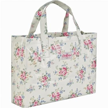 Our new open carry-all bags are great for when you have lots extra to carry, or when a standard size book bag just won?t do to hold all of your files and books! Finished in our durable oilcloth with a sturdy popper fastening and internal pocket, this spacious bag in our pretty Pinny Flowers print is great for when you?re on the go.