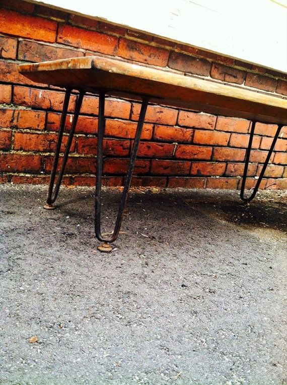 Midcentury bench coffee table with hairpin legs.