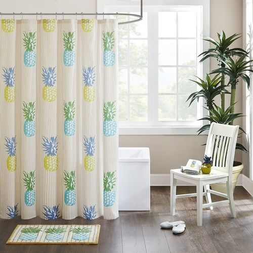 The modern tropical Kona Pineapple shower curtain adds color and beachy fun to your space with its printed yellow stripes and colorful pineapples in bold yellows and oranges on a textured cotton fabric.