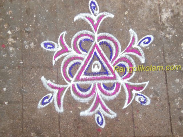Triangle kolam Its very simple and easy kolam... without dot this kolam is done and coloured with pink and violet.