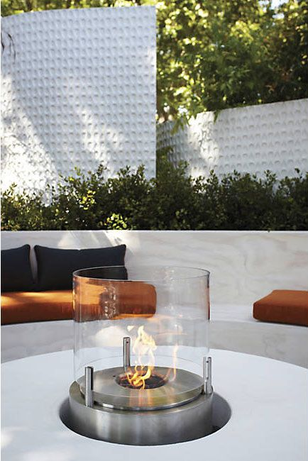 """Add some drama to any alfresco activity with the EcoSmart Fire Cyl Fireplace. This contemporary """"tea light"""" style fireplace is petite and portable. http://www.zocko.com/z/JHlIC"""