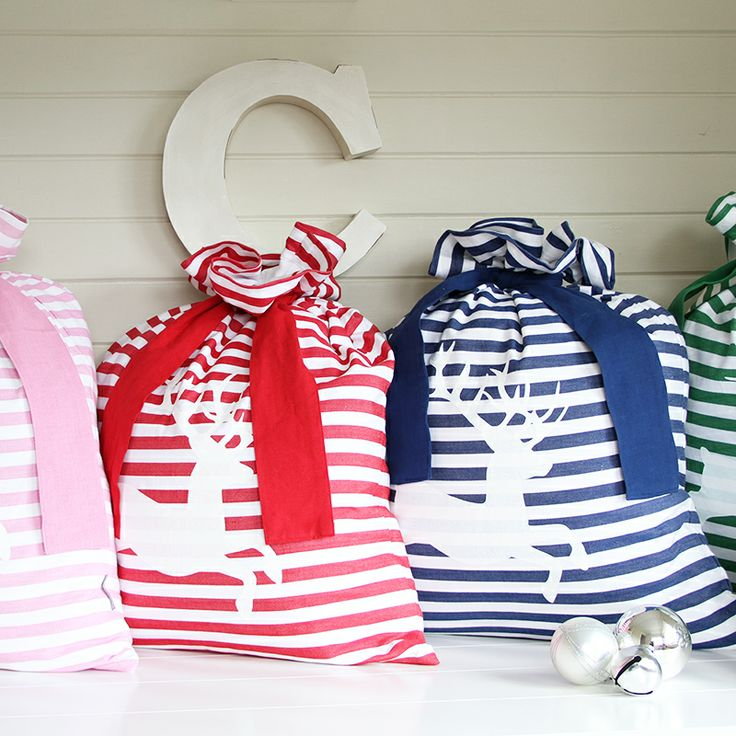 Classic Deer Santa Sacks.. These would look LOVELY under the tree!!