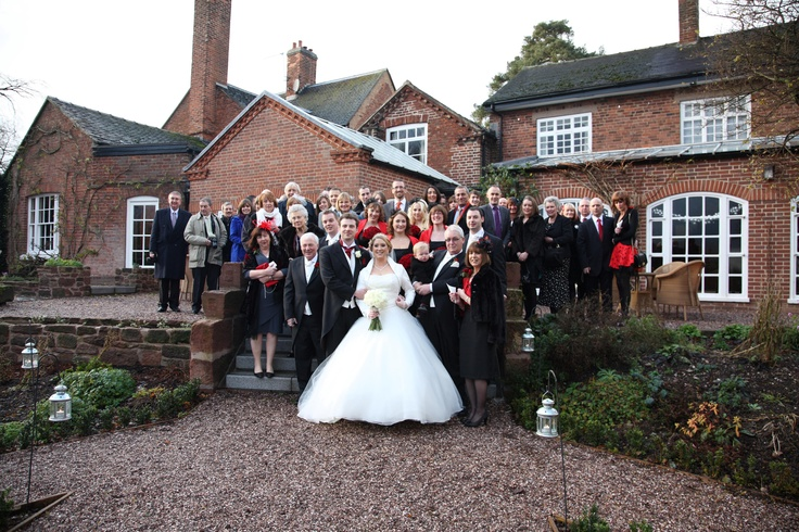 Mr & Mrs Hilton and their wedding guests all looking sharp. The groom wearing our Black morning suit with Emp red cravat.