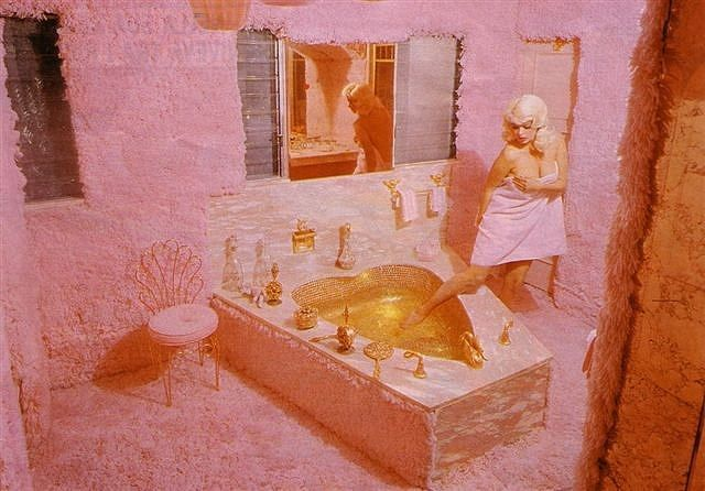 In November 1957 Jayne Mansfield bought a 40-room Mediterranean-style mansion and had it painted pink, with cupids surrounded by pink fluorescent lights, pink furs in the bathrooms, a pink heart-shaped bathtub, and a fountain spurting pink champagne.