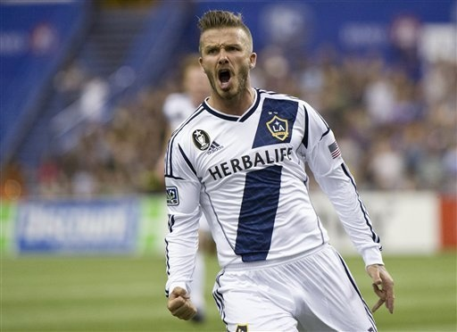 Soccer superstar David Beckham announced he will retire at the conclusion of the 2013 season. Take a look back at his career. #soccer #beckham #football