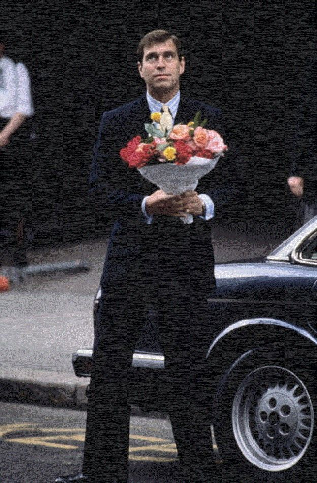 Prince Andrew, Duke of York arrives with flowers after the birth of his first daughter, Princess Beatrice, London, 9 Aug 1988