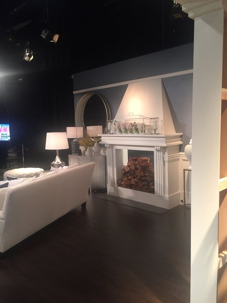 Real Housewives of Sydney Reunion Set - White Faux Fireplace in Formal Living Room Hamptons Style with White and Navy Patterned Cushions