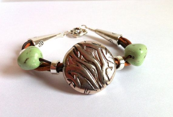 Green Turquoise Silver Brown Leather Cuff by ClearWaterDesignsbyK Https://clearwaterdesignsbyk.etsy.com Https://clearwaterdesigns.info This Green Turquoise, Silver & Brown Leather Cuff Bracelet will make a very Trendy Gift for Her! Green Chalk Turquoise & a Silver Toned Bead are wrapped with 3 colours of Genuine Cowhide Leather cord. This Bracelet is easy to wear with it's easy-on Toggle Clasp.  A Dynamite Christmas gift under $35.00