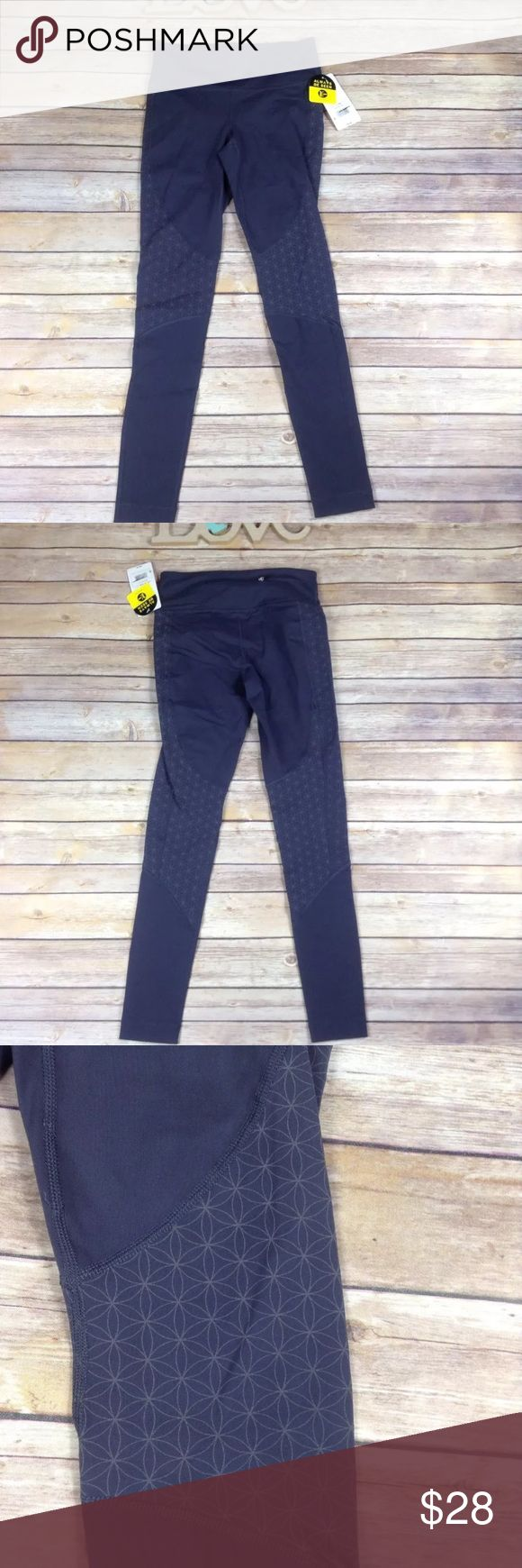 """C9 by Champion gray reflective workout leggings New with tags C9 by Champion women's size XS gray reflective workout yoga leggings. Excellent condition. No rips holes or stains. 88% nylon 12% spandex. Back zipper pocket. Retail $39.99  Measurements: Length- 33.5"""" Waist- 24""""-28"""" Inseam- 26.5""""  I ship fast! Pay before 4:30pm Monday thru Friday and I will ship the same day! Thank you for looking! Check out my other items! C9 Pants Leggings"""