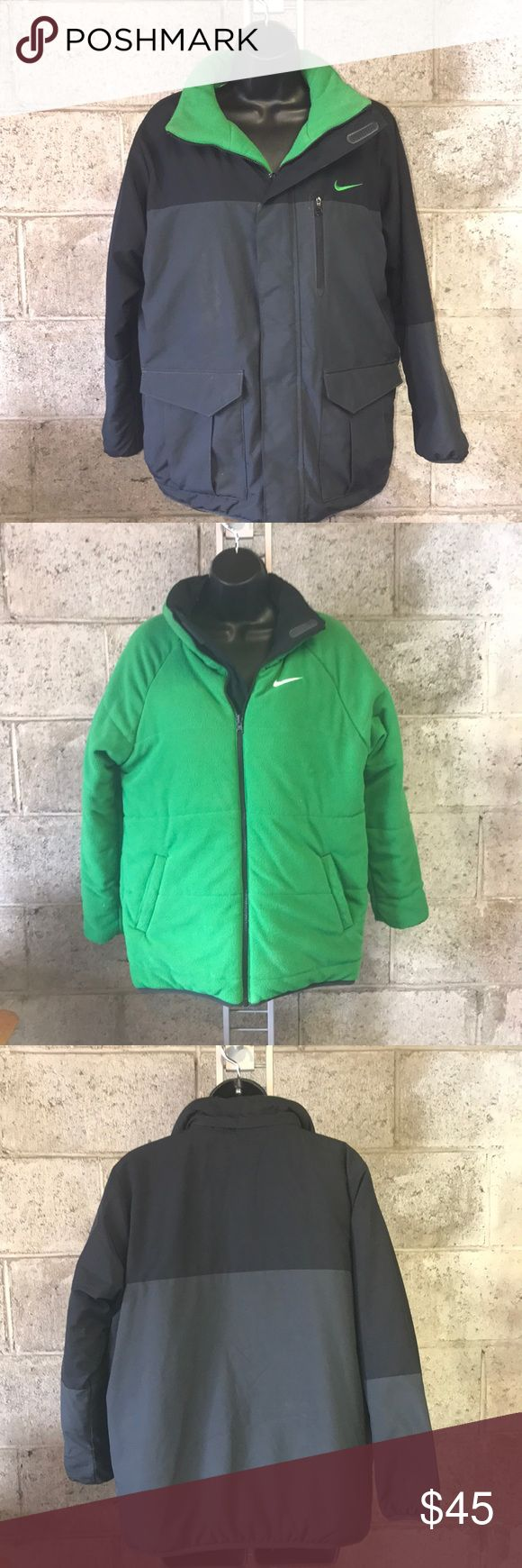 Reversible Nike winter coat NWOT Great condition. New without tags. Boys winter Nike jacket. Does not have hood. Reversible. Soft green on one side and black on the outside. Smoke and pet free home. Open to offers. Great for fall winter or school! Nike Jackets & Coats Puffers