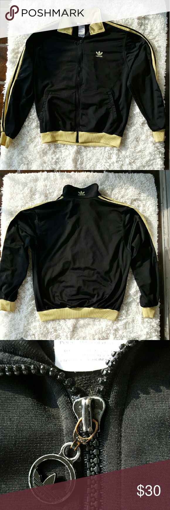"Adidas Men's Black and Yellow Zip Up Jacket Small Zip up black collared jacket from ADIDAS. Light yellow accents, stripes and logo embroidered. Preloved, worn and washed. The zipper pull is a little discolored otherwise jacket itself is flawless. Size Men's Small.  Approximate measurements laid flat- Pit to pit- 21"" Length- 24"" Sleeves- 23""  100% Polyester   #387 Adidas Jackets & Coats Lightweight & Shirt Jackets"