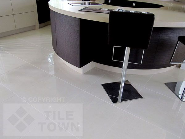 Lounge Ivory. This range of polished porcelain tiles have a gloss finish and would compliment a wide range of floor tile installations. This selection from RAK is available in 30x60cm & 60x60cm, with four colours Ivory, Light Grey, Black & Dark Grey.