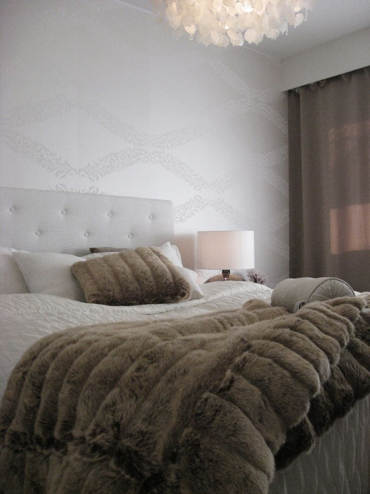White and brown bedroom, white button headboard