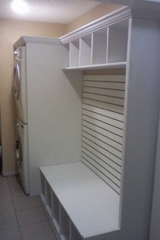 Custom built seat and storage for Laundry room. Front load full size stackable washer and dryer.