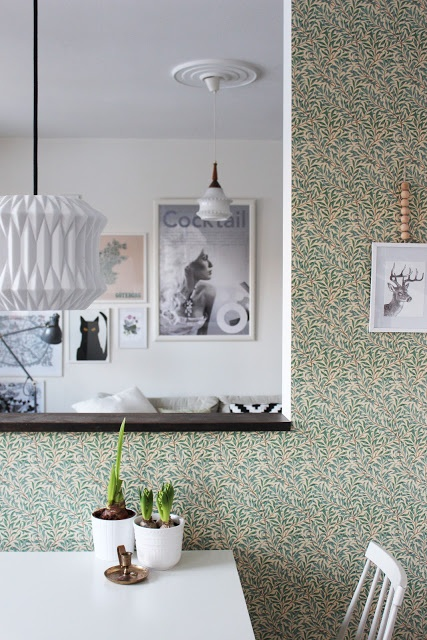 dainty vintage style wallpaper given a fresh twist with modern white furniture and fittings.