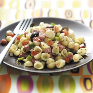 Salami Pasta Salad Recipe -The first time I tasted this delicious salad was at my wedding, and I recall, even in the blur of that day, the recipe was in high demand. That was years ago and I'm still asked to bring it to cookouts and parties! —Sarah Ryan, Geneva, Ohio