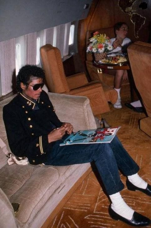 Michael is pictured during a flight during the Victory Tour in August 1984. He is reading a 'Life' Magazine which included an exclusive 12 page photo album of the musical tour of the decade [Victory] and a special feature on Michael on stage and off.