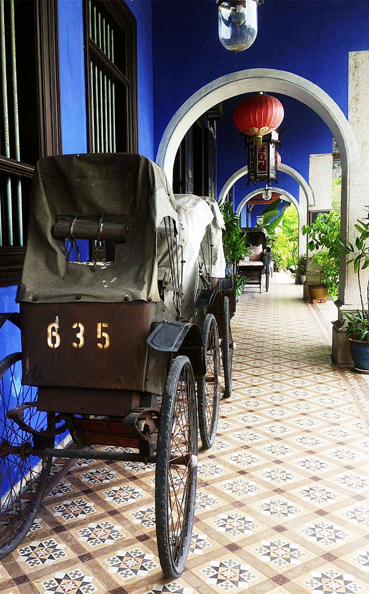 Vintage rickshaws line the shophouse corridors in the UNESCO World Heritage site of George Town, Penang #Indistay