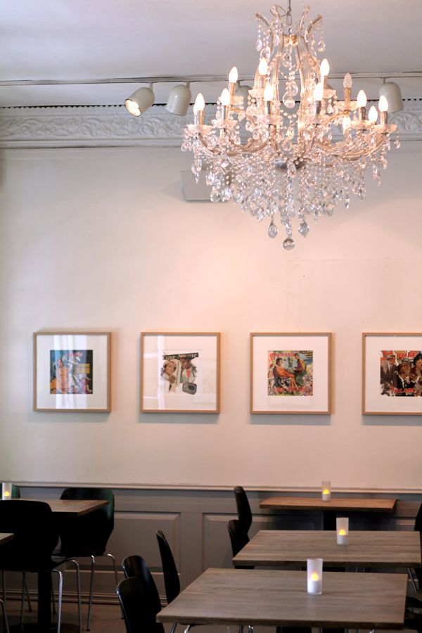 Chandelier and ornamental crown molding in 9 Muser cafe in Trondheim, Norway