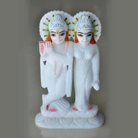 A masterpiece of the divine pair of Radha Krishanji crafted from pure Italian marble. Adding to the beauty is the unmatched embellishment work. A must for the puja room.Dimensions ( In Inches):9 X 5