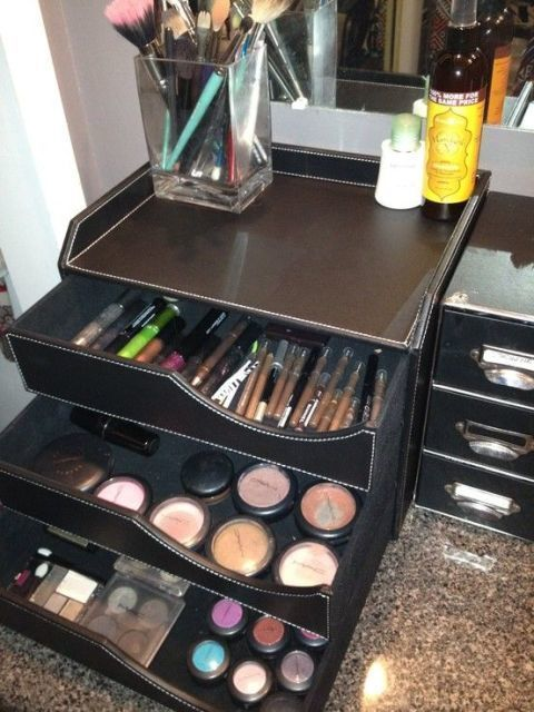Who said desk supplies have to be confined to a desk? Even though this leather desk organizer is usually stuck in the office, it's ideal for makeup, too. The sliding drawers offer enough space for brushes, blushes, you name it. Click through for more on this and other vanity organization ideas.