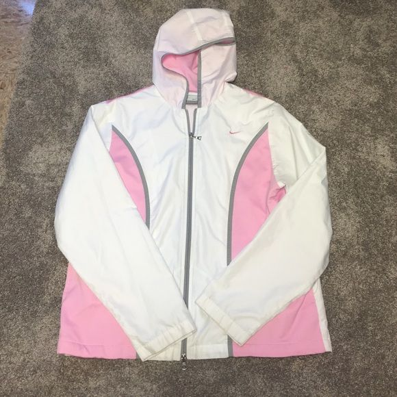 Nike Rain Jacket Nike Rain Jacket/ Windbreaker in perfect condition other than the zipper does not come apart at the bottom, it still zips up but I wore it as a pullover!  Nike Jackets & Coats