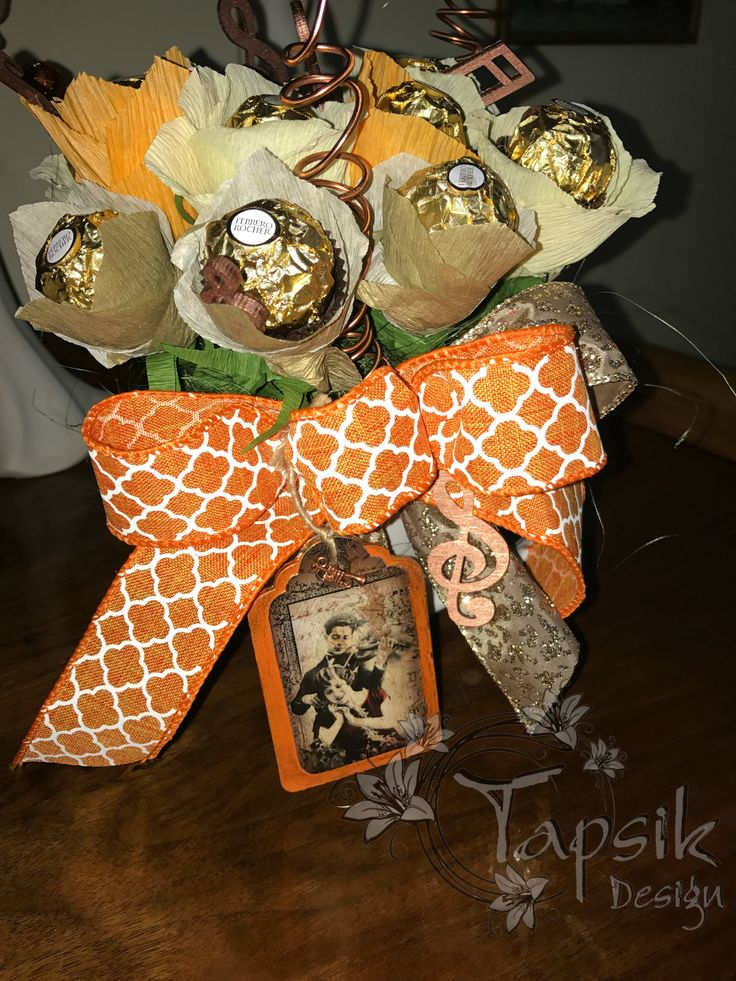 Chocolate bouquet in the orange-beige-gold. For music lover. With a bow, music notes and instruments. Decorated tag. In a mug. Notes and tag is hand decorated.
