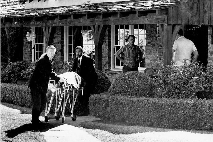 Coroner's office personnel wheel the body of film actress Sharon Tate from her home in Bel Air, Calif., August 9, 1969, after she and four others were found murdered.