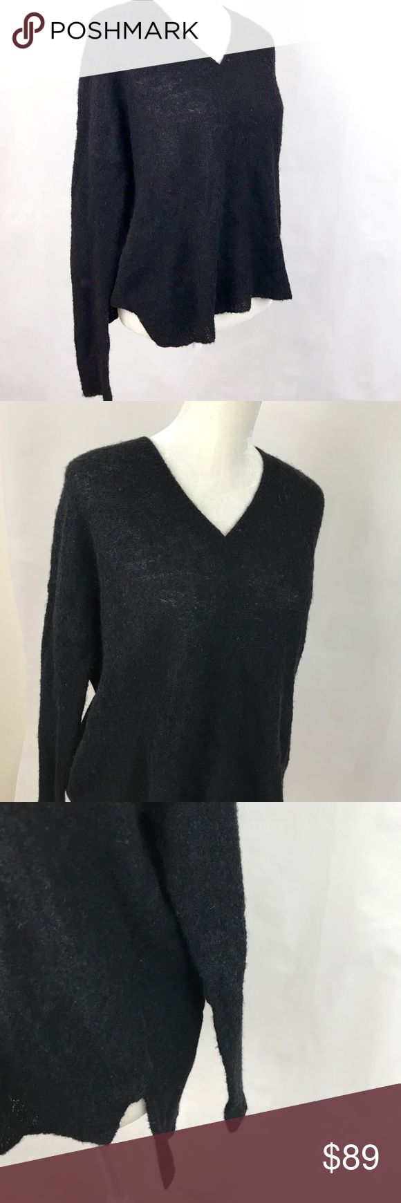 The Line Knit V Neck Black Sweater Wool Alpaca The Line designer women's v neck sweater. V neck knit. Lightly used. Line worn by Meghan Markle. Alpaca merino wool blend.   Armpit to armpit: 26 in Length: 25.5 in front, 29 back The Line Sweaters V-Necks