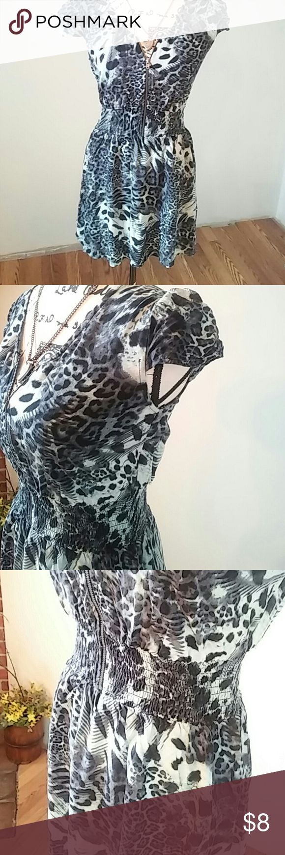 Blue Cheetah Print Dress Fun for any day. Zippered up front add a colorful tank unzip and liven it up for a night out with the girls!  **MEASUREMENTS ARE APPROXIMATE AND SUBJECT TO SLIGHT HUMAN ERROR.  Shoulder to Shoulder 14 inches Underarm to Underarm 15 inches Length 30 inches   Large  100% Rayon No Boundaries Dresses