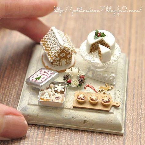 Miniature Christmas treats - Gingerbread house, holly cake, cookies, and puddings