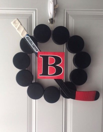Hockey Puck Wreath with Monogram by JRacres on Etsy https://www.etsy.com/listing/470948577/hockey-puck-wreath-with-monogram