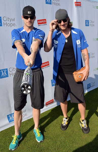 Brian Kelley (left and Tyler Hubbard of Florida Georgia Line attend the City of Hope Celebrity Softball Game during the CMA Festival on June 7, 2014, in Nashville.
