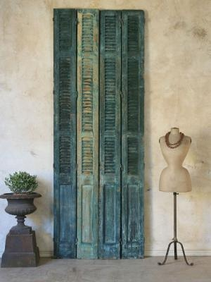 These rustic shutter doors would make a beautiful headboard
