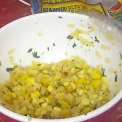 This is the best mango salsa I have ever tasted!  It's a refreshing, cool and spicy salsa that adds excitement to fish, poultry, pork or tortilla chips!  You'll love it!  If you're feeling adventurous, use fresh cilantro instead of basil--wonderful!