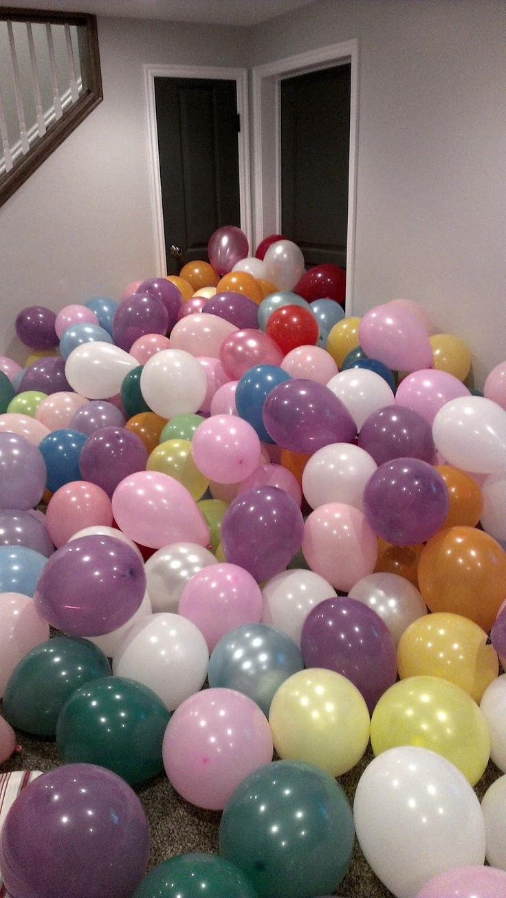 Fill a kid's room (or the room outside their room) with balloons for their birthday.