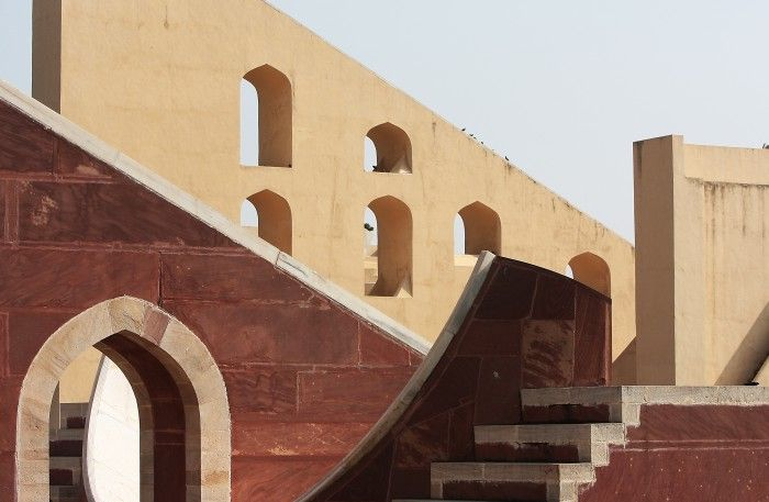 """Jaipur, India. The Jantar Mantar is a collection of architectural astronomical instruments in Jaipur (India). Built between 1727 and 1734, his name is derived from """"jantar"""" (""""instrument""""), and """"mantar"""" (""""formula"""", or in this context """"calculation""""). Therefore jantar mantar means literally """"calculation instrument"""". The observatory consists of fourteen major geometric devices for measuring time, predicting eclipses, tracking stars' location as the earth orbits around the sun, ascertaining the…"""