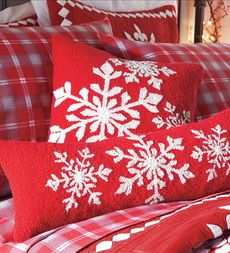 Christmas bedding (Inspiration for snowflake pillows.)  Cut snowflakes from felt, and use fabric glue to attach to pillows.
